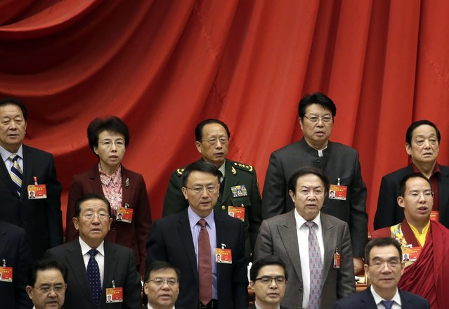 Delegates stand during the opening session of the Chinese People's Political Consultative Conference (CPPCC) at the Great Hall of the People in Beijing, March 3, 2015. REUTERS/Jason Lee