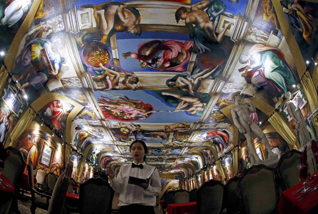 A waitress walks through the Galleria de Paco restaurant under a ceiling painted in tribute to the Sistine Chapel in Waterloo, Iowa, United States, January 16, 2016. (Photo by Jim Young/Reuters)