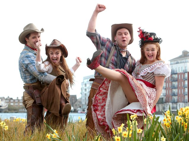 Ashley Day, Charlotte Wakefield, James O'Connnell and Lucy May Barker – members of the cast of classic American musical Oklahoma! have a showdown at Grand Canal Square as they brought some wild west to Dublin to celebrate the show's week long run at the Bord Gáis Energy Theatre on March 23, 2015. (Photo by Brian McEvoy/PA Wire)
