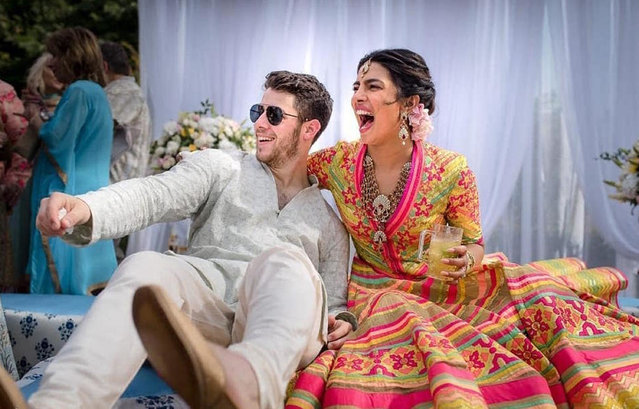 In this Friday, November 30, 2018 handout photo released by Raindrop Media, Bollywood actress Priyanka Chopra and Nick Jonas celebrate during a mehendi ceremony, a day before their wedding, at Umaid Bhawan in Jodhpur, India. (Photo by Raindrop Media via AP Photo)