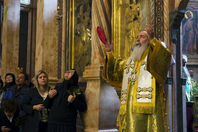 Greek Orthodox Patriarch of Jerusalem Metropolitan Theophilos (R) leads Palm Sunday mass in the Church of the Holy Sepulchre in Jerusalem's Old City April 5, 2015. (Photo by Ronen Zvulun/Reuters)