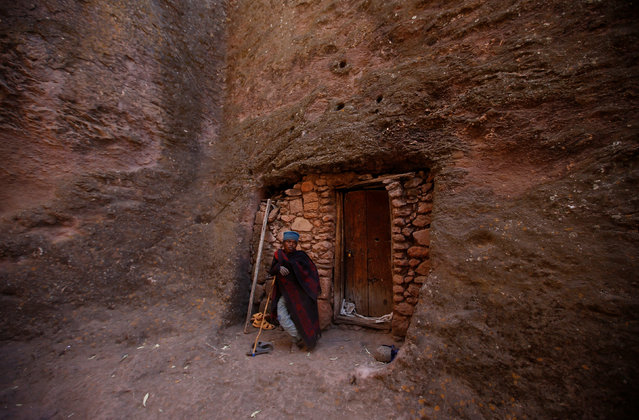 An Ethiopian Orthodox monk stands near one of the entrance of a rock hewn church ahead of Ethiopian Christmas in Lalibela, January 6, 2017, which is celebrated on January 7. (Photo by Tiksa Negeri/Reuters)
