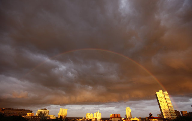 A rainbow is seen at dawn as clouds form a tropical storm over Havana, November 2009. (Photo by Desmond Boylan/Reuters)