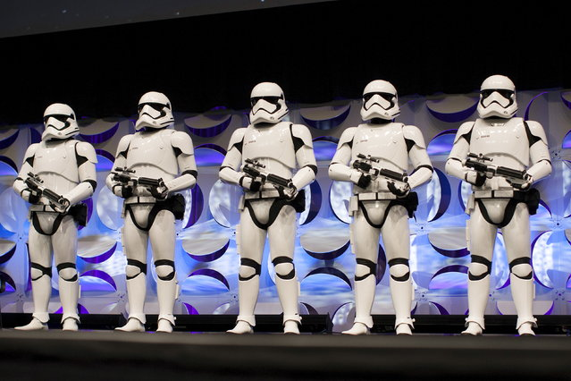 Redesigned stormtroopers appear onstage at the kick-off event of the Star Wars Celebration convention in Anaheim, California, April 16, 2015. (Photo by David McNew/Reuters)