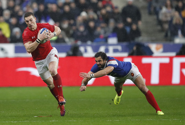 Wales' George North makes an interception and gets away from France's Yoann Huget before scoring his side's third try during the Six Nations rugby union international between France and Wales at the Stade de France in Saint Denis near Paris, Friday, February 1, 2019. (Photo by Christophe Ena/AP Photo)