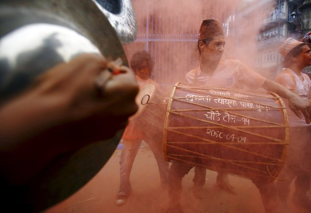 Devotees play traditional musical instruments while celebrating Sindoor Jatra vermillion powder festival at Thimi, in Bhaktapur April 15, 2015. (Photo by Navesh Chitrakar/Reuters)