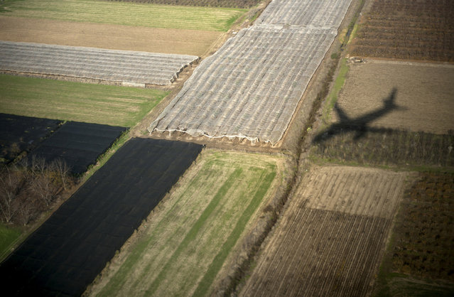 "U.S. Secretary of State John Kerry's plane casts a shadow on fields as it approaches Ben Gurion airport in Tel Aviv, Israel, Thursday, January 2, 2014. Kerry later said that finding peace between Israel and the Palestinians is not ""mission impossible"". (Photo by Brendan Smialowski/AP Photo)"