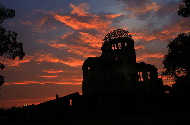 In this August 5, 2013 file photo, the Atomic Bomb Dome is silhouetted at sunset in Hiroshima, western Japan, a day before Hiroshima marks the 68th anniversary of the world's first atomic bombing. Seventy years after the U.S. defeated Japan in World War II, Americans are divided over Japan playing a more active military role in Asia – and most Japanese are opposed. (Photo by Shizuo Kambayashi/AP Photo)