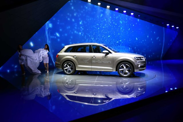 An Audi Q7 e-tron car is unveiled during a presentation at the 16th Shanghai International Automobile Industry Exhibition in Shanghai on April 20, 2015. (Photo by Johannes Eisele/Getty Images)