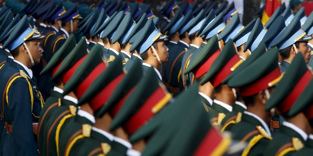 Soldiers attend a rehearsal for a military parade as part of the 40th anniversary of the fall of Saigon, in southern Ho Chi Minh City (formerly Saigon City), Vietnam, April 26, 2015. (Photo by Reuters/Kham)