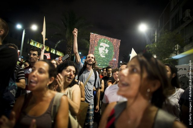 Israelis march as they protest against rising housing prices and social inequalities on July 30, 2011 in Tel Aviv, Israel