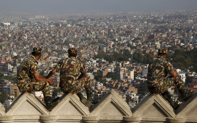 Soldiers look out across Kathmandu after the April 25 earthquake in Nepal, May 6, 2015. (Photo by Olivia Harris/Reuters)