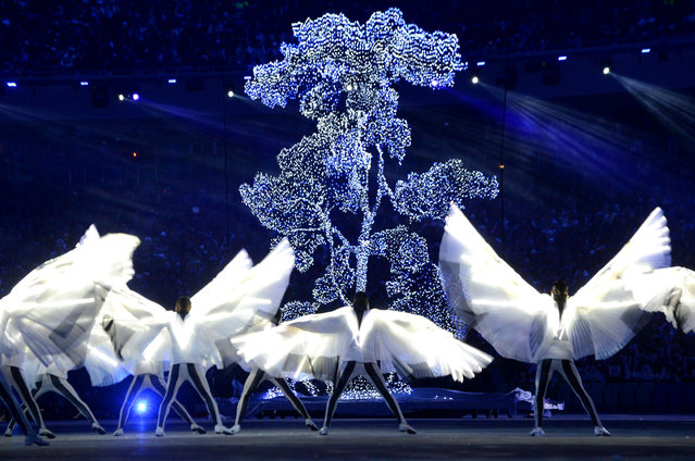 Artists perform during the Closing Ceremony of the Sochi Winter Olympics at the Fisht Olympic Stadium on February 23, 2014. (Photo by Kirill Kudryavtsev/AFP Photo)