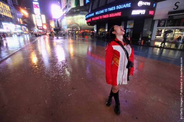 Yuria Celidwen tastes the rain in a nearly deserted Times Square as Hurricane Irene approaches