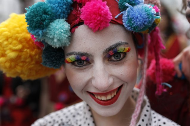 A woman poses for a photograph as she takes part of a Carnival parade in downtown Lisbon, Tuesday, March 4, 2014. (Photo by Francisco Seco/AP Photo)