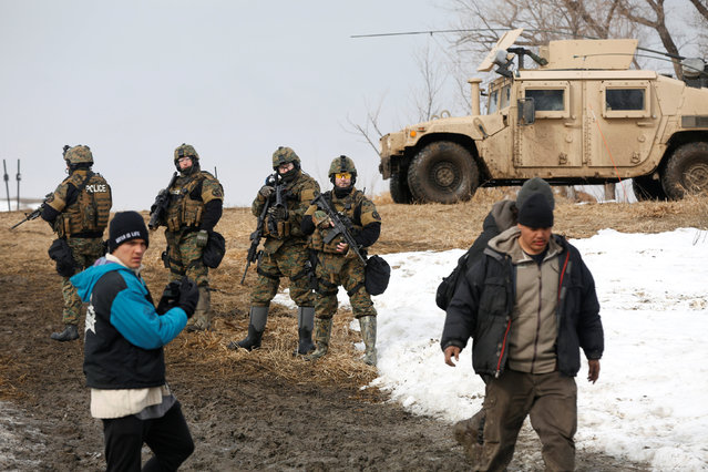 Protesters evacuate the main opposition camp against the Dakota Access oil pipeline near Cannon Ball, North Dakota, U.S., February 23, 2017. (Photo by Terray Sylvester/Reuters)