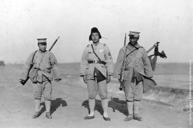 1922: Three Chinese soldiers at the time of a civil war in China
