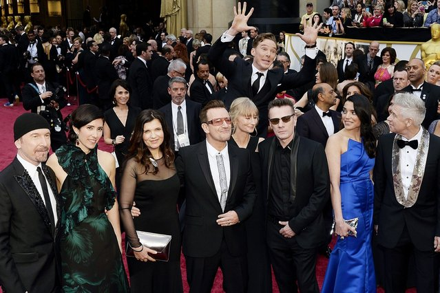 Actor Benedict Cumberbatch photo bombs U2 at the Academy Awards. (Photo by Kevork Djansezian/Getty Images)