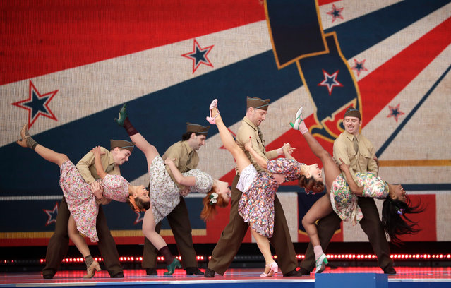 Dancers in period costume perform during an event to mark the 75th anniversary of D-Day in Portsmouth, England Wednesday, June 5, 2019. World leaders including U.S. President Donald Trump are gathering Wednesday on the south coast of England to mark the 75th anniversary of the D-Day landings. (Photo by Matt Dunham/AP Photo)