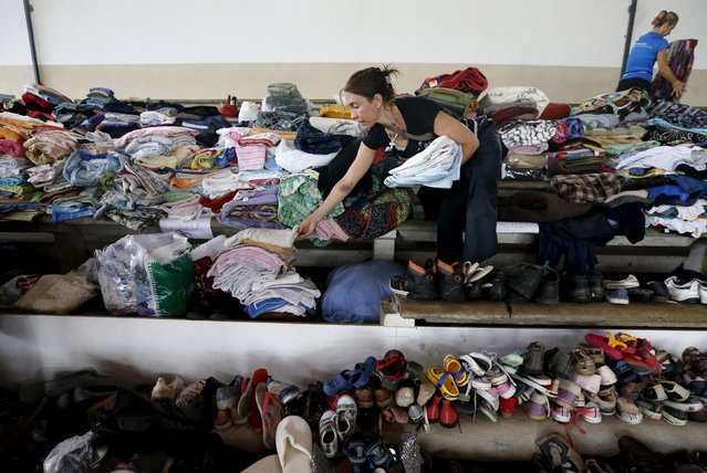 Volunteers classify donations at a temporary shelter in a public gym in Dolores, the day after the city was hit by a tornado, April 16, 2016. (Photo by Andres Stapff/Reuters)