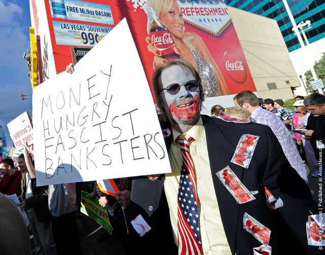 A protester affiliated with the Occupy Las Vegas movement, takes part in a march on the Las Vegas Strip