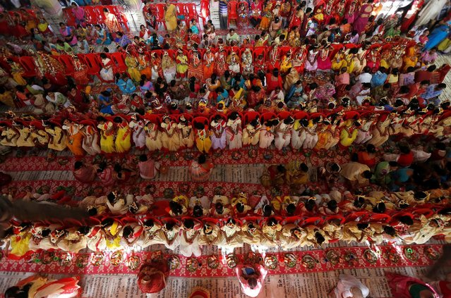 Hindu devotees worship young girls dressed as Kumaris during rituals to commemorate Navratri festival inside Adyapith temple on the outskirts of Kolkata, India, April 15, 2016. (Photo by Rupak De Chowdhuri/Reuters)