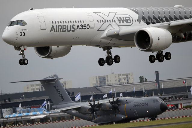 An Airbus A350 lands after its demonstration flight at the Paris Air Show, in Le Bourget airport, north of Paris, Thursday, June 18, 2015. Some 300,000 aviation professionals and spectators are expected at this weekends Paris Air Show, coming from around the world to make business deals and see dramatic displays of aeronautic prowess and the latest air and space technology. (AP Photo/Francois Mori)