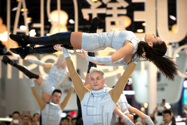 Dancers perform a routine at the Renault display at the Beijing International Automotive Exhibition in Beijing, Tuesday, April 26, 2016. (Photo by Mark Schiefelbein/AP Photo)