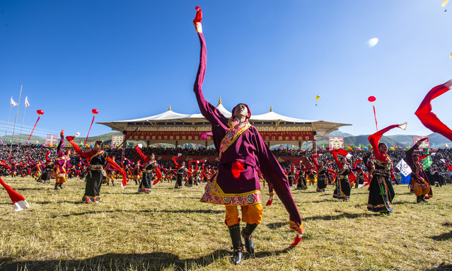 Tibetan people perform to celebrate the opening ceremony of the annual Qinghai Yushu Horse Racing Festival on July 25, 2019 in Yushu Tibetan Autonomous Prefecture, Qinghai Province of China. The Qinghai Yushu Horse Racing Festival is held on July 25-29 this year in Yushu. (Photo by Feng Jiangjiang/VCG via Getty Images)