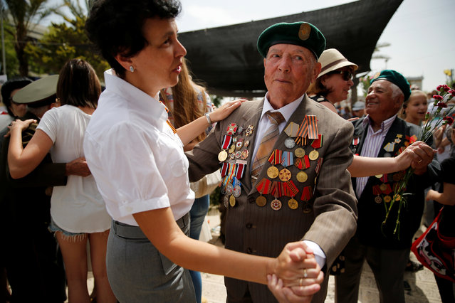 World War Two veterans dance during an event marking Victory Day, the anniversary of the victory of the Allies over Nazi Germany, in Ashdod, Israel, May 9, 2016. (Photo by Amir Cohen/Reuters)