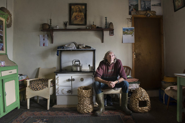 """The Basket Maker"". Bernie Winters is pictured in his traditional cottage. He is the last traditional Straw basket maker on Clare Island, County Mayo, West Coast Of Ireland. Rushes,Willow and straw are three materials that have been fundamental to Irish people from earliest times. Straw has many uses, including thatching houses, hens houses, bee skeps and súgán ropes among other traditionally made items. (Photo and caption by Michael Mc Laughlin/National Geographic Photo Contest)"