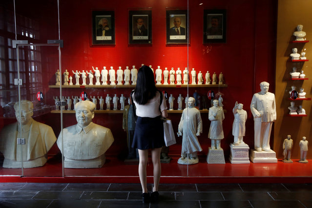 A visitor looks at a display of porcelain figures of the late Chinese Chairman Mao Zedong at Jianchuan Museum Cluster in Anren, Sichuan Province, China, May 13, 2016. (Photo by Kim Kyung-Hoon/Reuters)