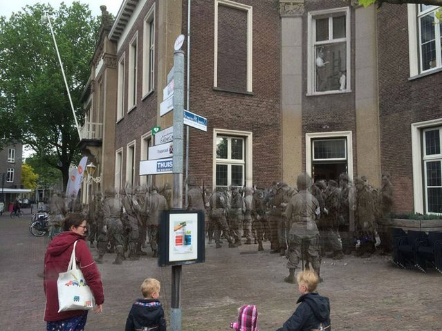 Caught: Paratroopers of the 101st Airborne, 501st PIR gather prisoners at the city hall in Veghel. 1944 – 2014. (Photo by Adam Surrey)