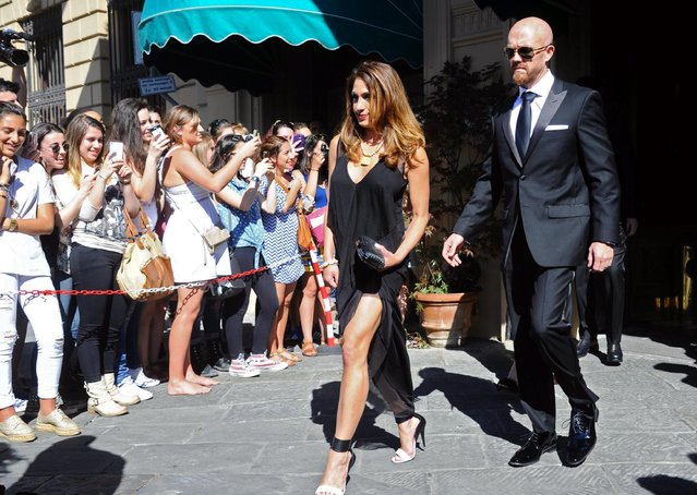 Unidentified guests walk out of the hotel for the wedding of Kim Kardashian and Kanye West in Florence, Italy, 24 May 2014. The wedding party will be hold at Forte di Belvedere, Florence, on 24 May. (Photo by Maurizio Degl' Innocenti/European Pressphoto Agency)