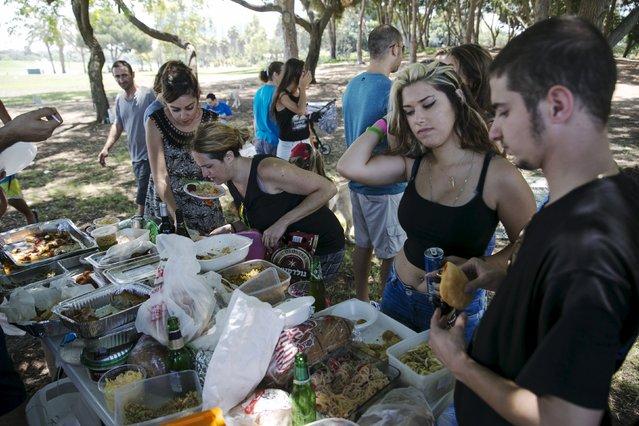 People attend a vegan picnic at Hayarkon Park in Tel Aviv, Israel July 18, 2015. (Photo by Baz Ratner/Reuters)