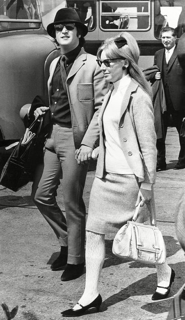 John Lennon flies out to the Cannes Film Festival with his first wife Cynthia Lennon allegedly icognito wearing dark glasses and a green velour hat, 1965. (Photo by H. Wallace/Daily Mail/Rex Features/Shutterstock)