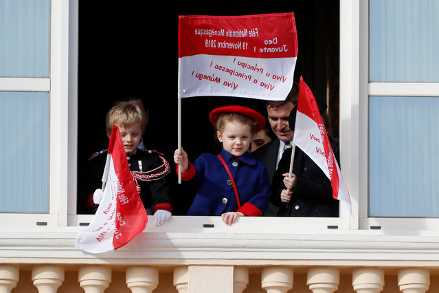 Monaco's Prince Jacques and Princess Gabriella stand on the palace balcony during the celebrations marking Monaco's National Day in Monaco, November 19, 2019. (Photo by Eric Gaillard/Reuters)