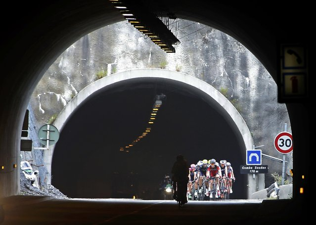 The pack of the riders cycle through a tunnel during the 110.5-km (68.6 miles) 20th stage of the 102nd Tour de France cycling race from Modane to Alpe d'Huez in the French Alps mountains, France, July 25, 2015. (Photo by Eric Gaillard/Reuters)