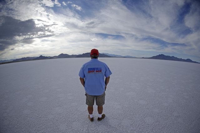 In this Monday, July 20, 2015 photo, Bill Lattin, the Southern California Timing Association president and Speed Week race director, stands in the Bonneville Salt Flats in Utah. (Photo by Rick Bowmer/AP Photo)