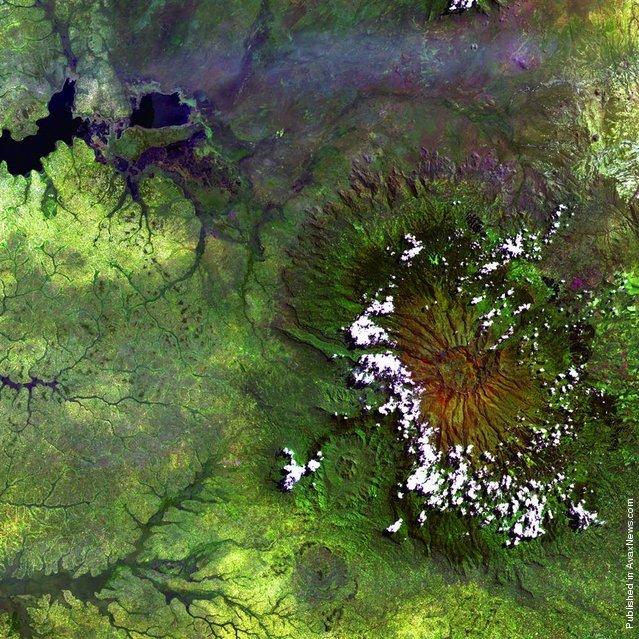 Clouds encircle the lofty rim of Africa's Mount Elgon, a huge, long-extinct volcano on the border between Uganda and Kenya