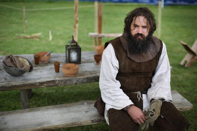 A re-enactor takes a break during rehearsal for the Battle of Bannockburn Live event on June 27, 2014 in Stirling, Scotland. The 700th anniversary of the historic battle that saw outnumbered Scots army conquer the English led by Edward II in the First War of Scottish Independence. (Photo by Peter Macdiarmid/Getty Images)