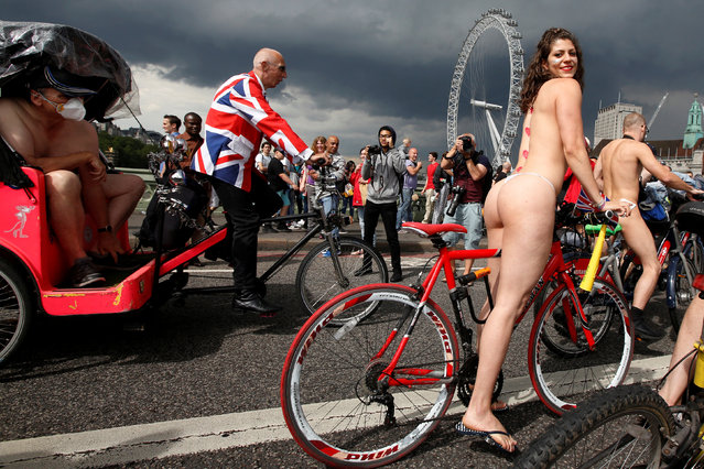 Cyclists participate in the World Naked Bike Ride, which organisers say is a protest against reliance on cars and oil, on Westminster Bridge London, Britain June 11, 2016. (Photo by Luke MacGregor/Reuters)