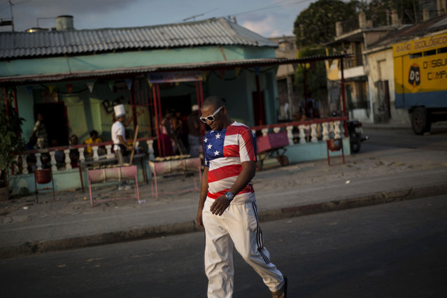 In this March 21, 2015 photo, a man wears a shirt with a U.S. flag design in Santiago, Cuba. (Photo by Ramon Espinosa/AP Photo)