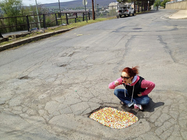 Funny pothole art: Cereal bowl pothole. (Photo by Caters News)