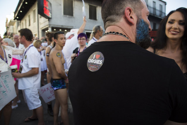 A provocative sticker is displayed on Michael Bell's t-shirt during the Sexual Freedom Parade, part of Naughty in N'awlins held in New Orleans, Louisiana, Wednesday July 5th, 2017. (Photo by Mathew Growcoot/News Dog Media)