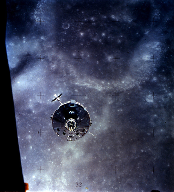 "In this photo, the Apollo 16 Command and Service Module (CSM) ""Casper"" approaches the Lunar Module (LM). The two spacecraft were about to make their final rendezvous of the mission, on April 23, 1972. Astronauts John W. Young and Charles M. Duke Jr., aboard the LM, were returning to the CSM in lunar orbit after three successful days on the lunar surface. Astronaut Thomas K. Mattingly II was in the CSM. (Photo by NASA)"