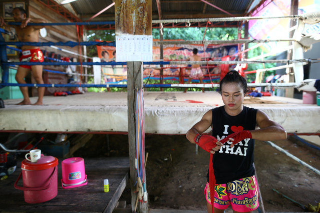Muay Thai boxer Nong Rose Baan Charoensuk, 21, who is transgender, trains at a gym in Buriram province, Thailand, July 3, 2017. (Photo by Athit Perawongmetha/Reuters)