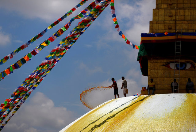 A man splashes paint on the dome of Boudhanath Stupa, a UNESCO world heritage site famous among tourists, in Kathmandu, Nepal August 2, 2017. (Photo by Navesh Chitrakar/Reuters)