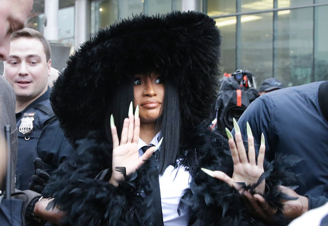 Rapper Belcalis Marlenis Almánzar, known professionally as Cardi B arrives at Queens Criminal Court on December 10, 2019 in New York City to answer charges over strip club incident. Cardi B has been charged in a 14-count indictment, including two counts of felony attempted assault on two bartenders at Angels Strip Club in the Flushing section of Queens. (Photo by John Angelillo/UPI/Barcroft Media)