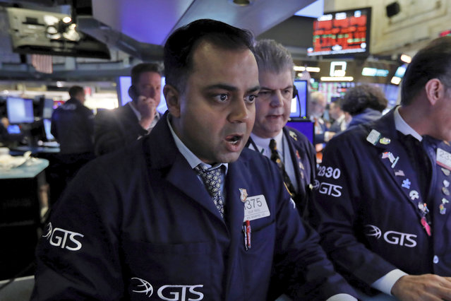 Specialist Dilip Patel, left, works at his post on the floor of the New York Stock Exchange, Monday, March 9, 2020. The Dow Jones Industrial Average sank 7.8%, its steepest drop since the financial crisis of 2008, as a free-fall in oil prices and worsening fears of fallout from the spreading coronavirus outbreak seize markets. (Photo by Richard Drew/AP Photo)